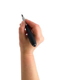 The hand with a pen drawing. Illustration of the hand with a pen drawing on the white paper background with copy space stock photos