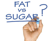Hand with Pen Drawing Fat vs Sugar Question. In accordance with low sugar weightloss lifestyle stock images