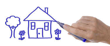Hand with Pen Drawing House and Tree Stock Image