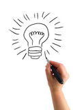The hand with a pen drawing light bulb royalty free illustration