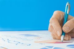 Hand with Pen Editing Graphs royalty free stock images