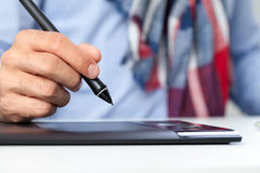Hand with pen  and graphics tablet Royalty Free Stock Photography
