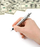 Hand with pen and money Royalty Free Stock Photos