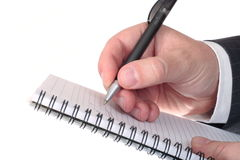 Hand with pen and notepad Royalty Free Stock Images