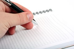 Hand with pen and notepad Royalty Free Stock Photo