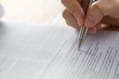 Hand with pen over application Royalty Free Stock Photo