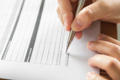 Hand with pen over application Stock Photo