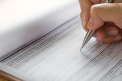 Hand with pen over application Royalty Free Stock Images