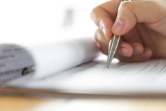 Hand with pen over application Stock Image
