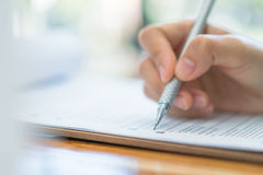 Hand with pen over application form . Royalty Free Stock Photos