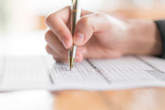 Hand with pen over application form . Hand with pen over application form Royalty Free Stock Photos