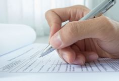 Hand with pen over application form Royalty Free Stock Photo