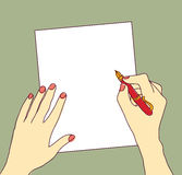 Hand with pen and paper writing color Stock Photography