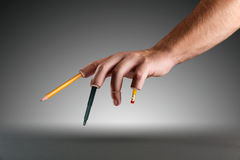 Hand with pen and pencils instead of fingers Royalty Free Stock Images