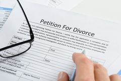 Hand with pen on petition for divorce paper Royalty Free Stock Photo
