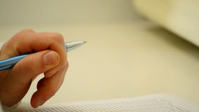 Hand with a pen, plane resource stock video footage