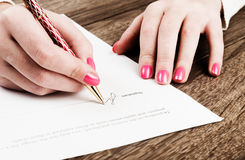 Hand with pen signing a contract. Stock Photography