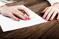 Hand with pen signing a contract. Royalty Free Stock Photography
