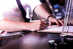 Hand with pen signing document, close up Royalty Free Stock Images