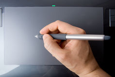 Hand on Pen Tablet Royalty Free Stock Photo