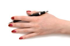 Hand with pen top view Royalty Free Stock Image