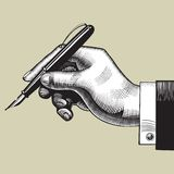 Hand with a pen. Vintage engraving drawing of hand with a pen. There is in addition a vector format (EPS 8 Stock Photography