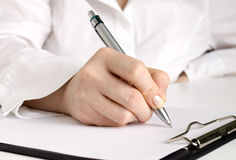 Hand with pen writing Royalty Free Stock Photography