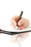Hand with pen writing Stock Image
