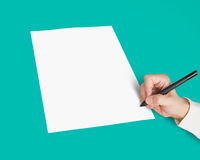 Hand with pen writing on blank white paper Royalty Free Stock Photos