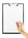 Hand with pen writing on clipboard on white Royalty Free Stock Photo