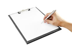 Hand with pen writing on clipboard Stock Photo