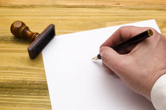 Hand with pen writing on empty paper Royalty Free Stock Photo