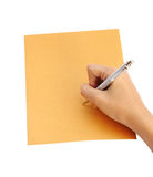 Hand with pen writing on the envelope Royalty Free Stock Photo