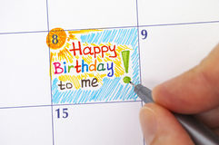 Hand with pen writing reminder Happy Birthday to me. Person hand with pen writing reminder Happy Birthday to me in calendar Stock Photography