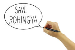 Hand with pen writing Save Rohingya refugee from human trafficki. Ng in bubble on pure white background Royalty Free Stock Photography