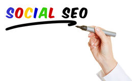 Hand with pen writing Social SEO Stock Photo