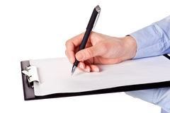 Hand with pen writing on the white page Royalty Free Stock Photography