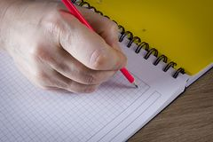 Hand with a pencil Royalty Free Stock Photography