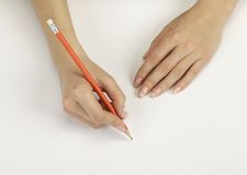Hand with a pencil royalty free stock image