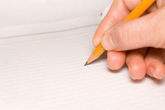Hand with pencil. Hand writing text / drawing with pencil Royalty Free Stock Images