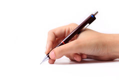Hand with pencil. Hand holding a pencil on white background Stock Photo