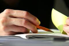 Hand with pencil. Young woman hand close-up with pencil and notebook Royalty Free Stock Photography