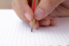 Hand and pencil Stock Images