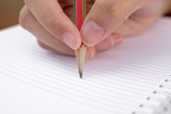 Hand and pencil Stock Image