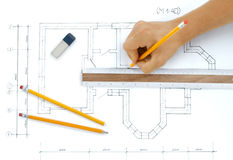 Hand with pencil drawing. Construction plan Royalty Free Stock Photos