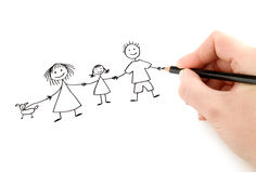 Hand with pencil drawing happy family. On the white page Royalty Free Stock Photo