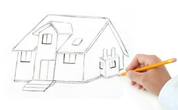 Hand with pencil drawing house Royalty Free Stock Photography