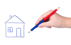 Hand with pencil drawing house. Stock Image
