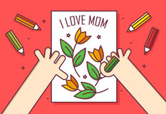 Hand with pencil draws a card with flowers. I love Mom. Thin line flat design greeting card. International Women`s Day. Royalty Free Stock Images
