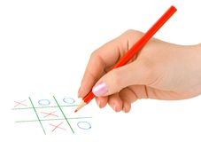 Hand with pencil and game Royalty Free Stock Photos